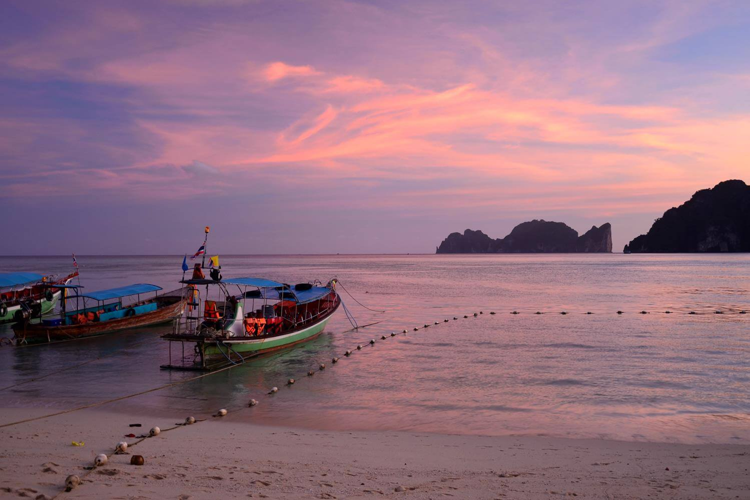 Thailand: Sea and fishing boats at sunset
